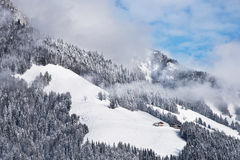 Two winter chalets by the mountain Royalty Free Stock Images