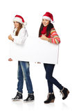 Two winter females with banner Stock Image