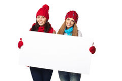 Two winter females with banner Royalty Free Stock Images