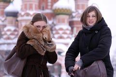 Two winter girls Stock Photos
