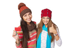 Two winter girls showing blank card Stock Images