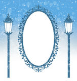 Two winter lampposts and frame in snowfall on light blue Royalty Free Stock Photography