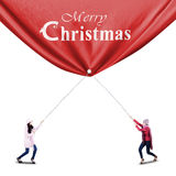 Two winter woman pulls a christmas banner Stock Images