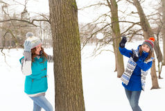 Two Winter women have fun outdoors Stock Photos