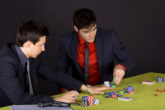 Two wise guys playing poker Stock Photos