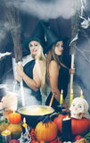 Two witches with a broom, tinted Stock Photography
