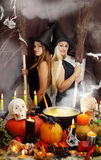 Two witches with a broom, tinted Royalty Free Stock Image