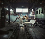 Two witches in the old and empty railway station Royalty Free Stock Photo