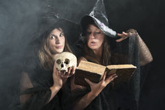 Two witches pronouncing magic formulas Royalty Free Stock Image