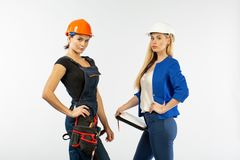 Two woman architecture look in plan and discussing the problems of building on white background. Two women architecture look in plan and discussing the problems stock photo