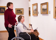 Two woman in art gallery royalty free stock photos