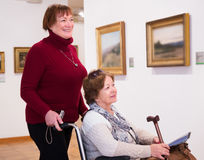 Two woman in art gallery Stock Images