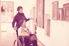 Two woman in art gallery Royalty Free Stock Photo