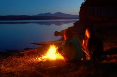 Two woman on beach lake. Two woman on trip,night lake Stock Photography