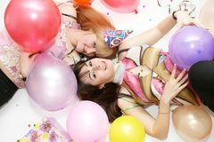 Two woman celebrating birthday Stock Image