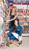 Two woman choose food. In supermarket Stock Photography