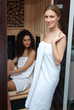 Two woman in compact sauna Royalty Free Stock Images