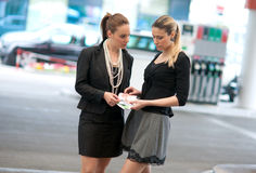 Two woman counting money Royalty Free Stock Photography
