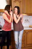 Two woman with croissant Royalty Free Stock Photos