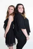 Two woman with different body shapes back to back Royalty Free Stock Photos