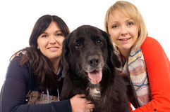 Two Woman and Dog Royalty Free Stock Photo