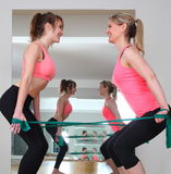 Two woman doing exercise with Fitness Bands Royalty Free Stock Image