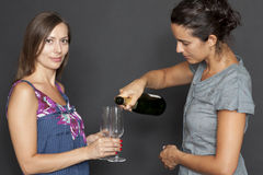 Two woman drinking champagne Royalty Free Stock Photo