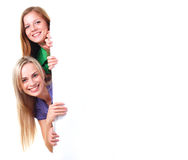 Two woman and empty baner Royalty Free Stock Photography