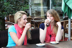 Two woman enjoying a cool refreshing drink Royalty Free Stock Photos
