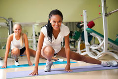 Two woman at the fitness club stock photos