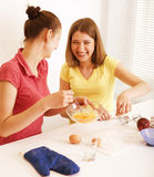 Two woman friend cooking together, having fun Royalty Free Stock Photos