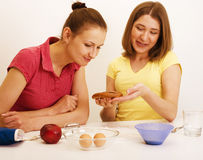 Two woman friend cooking together Stock Photos