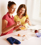 Two woman friend cooking together Royalty Free Stock Image