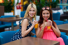 Two woman friends drinking juice in bar Stock Photo