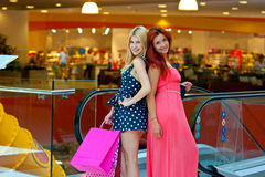 Two woman friends in shopping mall Royalty Free Stock Image