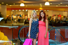 Two woman friends in shopping mall Stock Photos