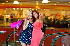 Two woman friends in shopping mall Stock Images