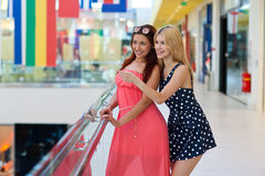 Two woman friends in shopping mall Royalty Free Stock Images