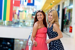 Two woman friends in shopping mall Royalty Free Stock Photography
