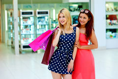 Two woman friends in shopping mall with bags Royalty Free Stock Images