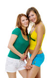 Two woman friends standing together Stock Images