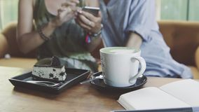 Two woman friends use smartphone. Cake and cup of latte on the table. Two woman friends use smartphone. Cake and cup of latte matcha on the table stock video