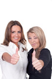 Two woman giving a thumbs up gesture Royalty Free Stock Image