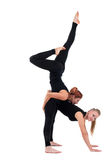 Two woman gymnast in black show acrobatic exercise Stock Image