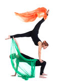 Two woman gymnast posing with flying fabric Royalty Free Stock Photography
