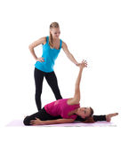 Two woman gymnast trainer help doing stretch Royalty Free Stock Photos