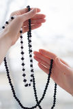 Two woman hands with glassbeads Stock Photography