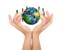 Two woman hands hold earth of social network Stock Photo