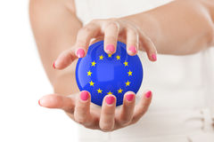 Two Woman Hands Protecting European Union Flag Earth Globe Spher. E on a white background Royalty Free Stock Photo