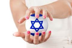 Two Woman Hands Protecting Israel Flag Earth Globe Sphere. Two Woman Hands Protecting Israel Flag Earth Globe Sphere on a white background Royalty Free Stock Image